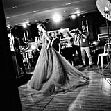 Photographers get a sneak peek at a look by Elie Saab before the curtain goes up on the show.