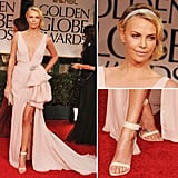 Charlize Theron lit up the Golden Globes red carpet in the most feminine Dior gown. Christian Dior Couture feels utterly romantic and just a little '20s-inspired — a vibe she furthers with soft, side-swept waves and a beautiful embellished headband.