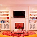 We would love to cozy up and watch some MTV reruns in this living room.