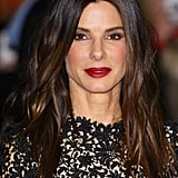 At the London premiere of Gravity, Sandra Bullock looked positively gorgeous with glossy waves and a deep red lipstick hue.