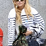 Ashley Olsen carried a camouflage-print bag.