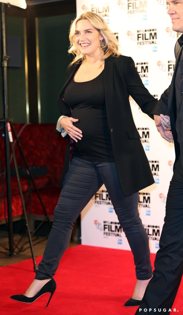 Kate Winslet placed her hand on her baby bump.