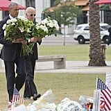 President Obama and Vice President Biden carry white roses to place at a memorial for the victims of the Orlando shooting.