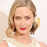 Click too fast, and you'll miss Emily Blunt's tinted bobby pin. This retro coiffure would have held up fine without it, but the addition brought a modern touch to her vintage glamour.