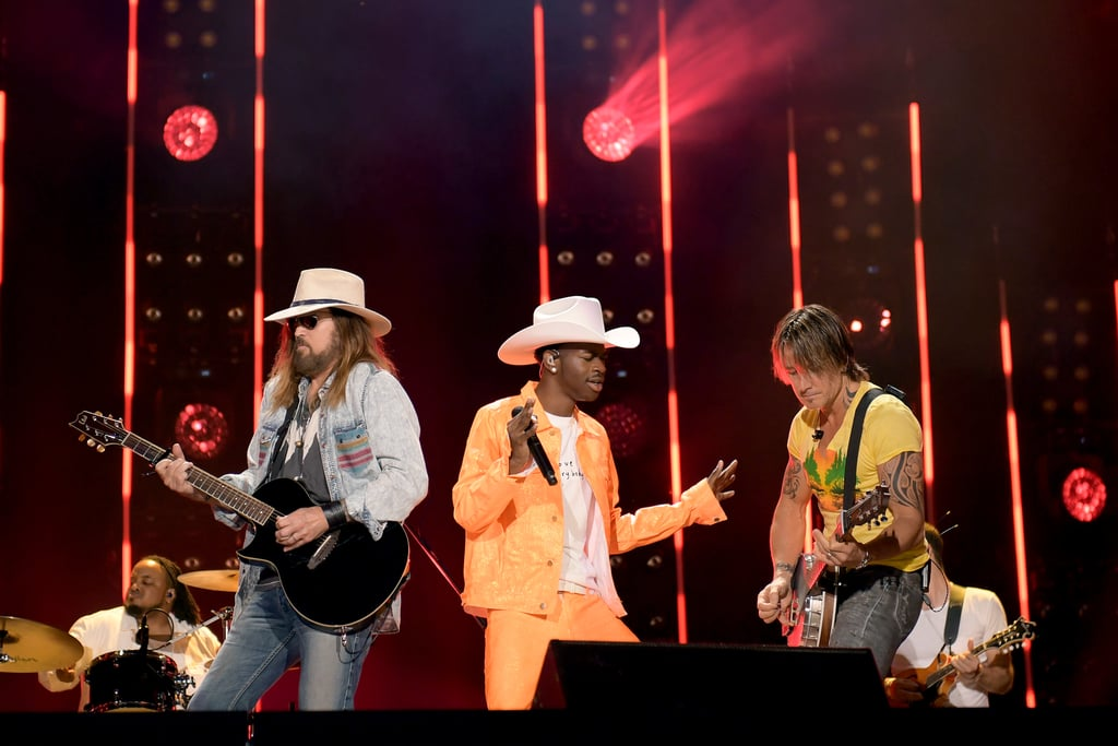 "Lil Nas X, Billy Ray Cyrus, and Keith Urban took their horses to the CMA Fest in Nashville on Saturday night! The trio united on stage to perform a power-packed live rendition of Lil Nas X and Cyrus's remixed hit ""Old Town Road."" While the young rapper was clad in a bright orange ensemble with a white cowboy hat, Cyrus rocked a denim outfit and Urban wore a t-shirt with jeans.  As soon as the song's first few chords began to play, the crowd went wild — which is understandable considering ""Old Town Road"" is a bonafide bop. After the show, Lil Nas X shared a clip from their set, adding, ""Thank u billy & keith !!!"" Keith also expressed his gratitude for getting to play with Lil Nas X and Cyrus on Instagram, writing, ""Nas's t shirt says LOVE EVERYBODY ...... I can't think of a better caption than that right there!!! @lilnasx and @billyraycyrus - thank u for the invite- I loved playing with u both and hope we get to do it again!!!!"" Can we get a Lil Nas X, Cyrus, and Urban joint album next? Please and thank you."