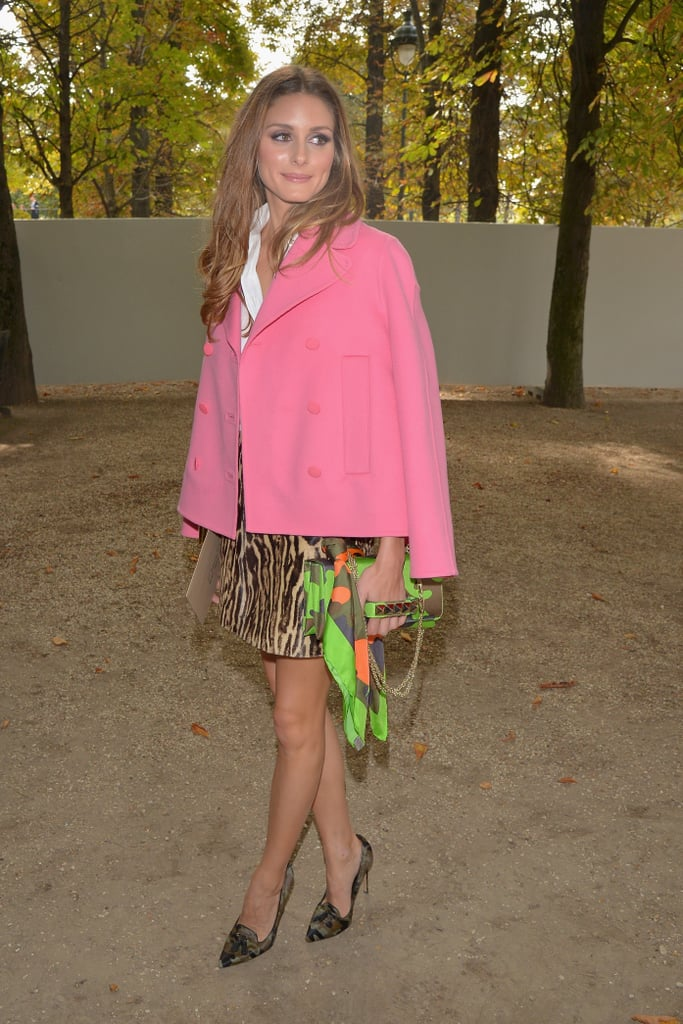 Olivia Palermo tempered a leopard-print miniskirt with a bright pink peacoat while taking in the shows during Paris Fashion Week Spring/Summer 2014. In true Olivia fashion, the star finished her look with camouflage pumps and a matching Valentino bag.  Where to Wear: Champagne brunch with Mom. Valentine's Day is about celebrating all loved ones.