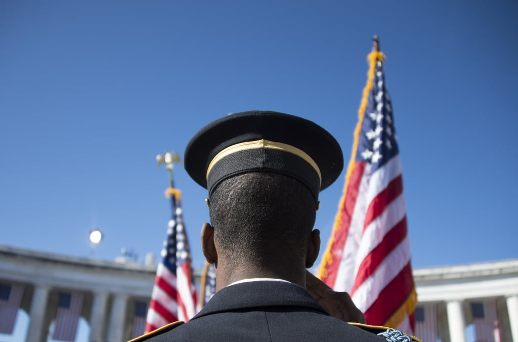 A member of the US Army Honor Guard saluted the flag at the Veterans Day ceremony at Arlington National Cemetery.
