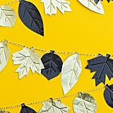 Don't spend a fortune on a premade garland when you can handcraft one as elegant as this DIY Fall leaf metal garland.