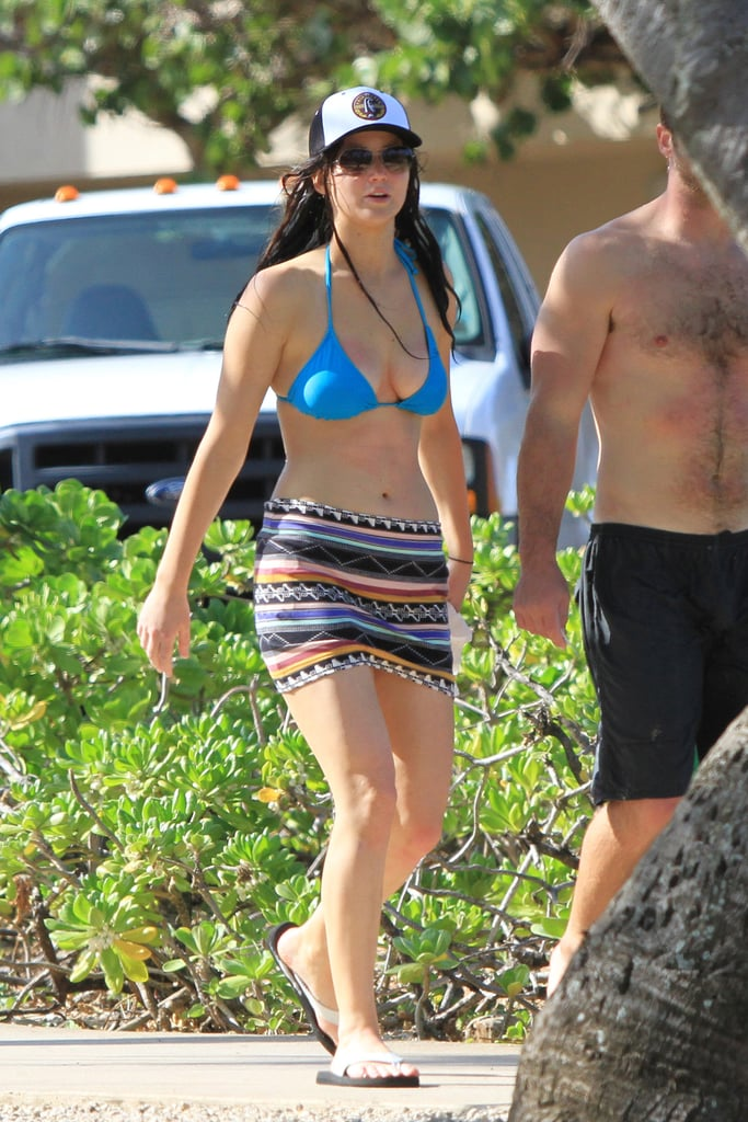 Jennifer Lawrence took advantage of a break in her schedule and headed to Hawaii for Thanksgiving with her family. Jennifer slipped into a blue string bikini, which showed off her toned body, to hit the beach on Wednesday afternoon. Jennifer has been on the road promoting Silver Linings Playbook, which is earning rave reviews and early award-season buzz, as it makes its wide release this holiday. Looking for a movie to see over the long weekend? Check out BuzzSugar's Thanksgiving movie guide! While out doing interviews for Silver Linings Playbook, Jen shared some of her usual candid and hilarious anecdotes, including one about a near miss with Honey Boo Boo that earned her some headlines. She stayed pretty tight-lipped on Catching Fire, the next movie in the Hunger Games series, though she is still rocking her dark Katniss locks.