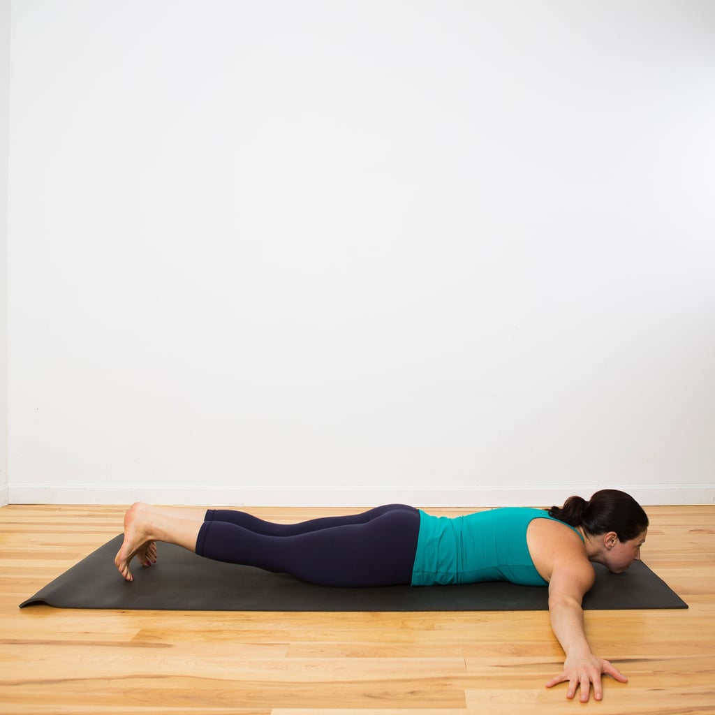 Begin lying on your belly with your arms out wide, palms facing down and in line with the shoulders. Tuck the toes.