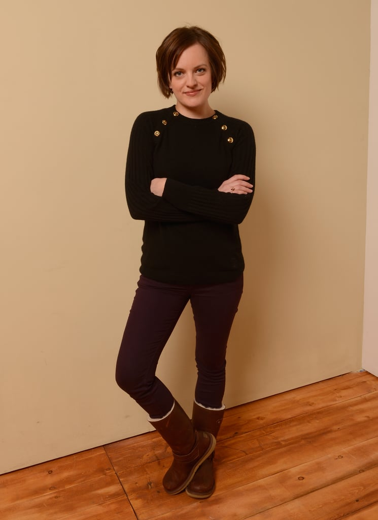 Elisabeth Moss was cute and cozy in a ribbed Tory Burch sweater, plum denim, and shearling boots.