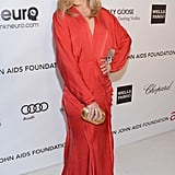 Mena Suvari wore a bright red dress to Elton John's Oscar party.