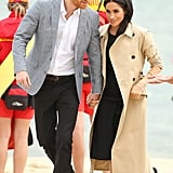 Meghan Markle Wearing a Club Monaco Dress, Martin Grant Trench and Ballet Flats