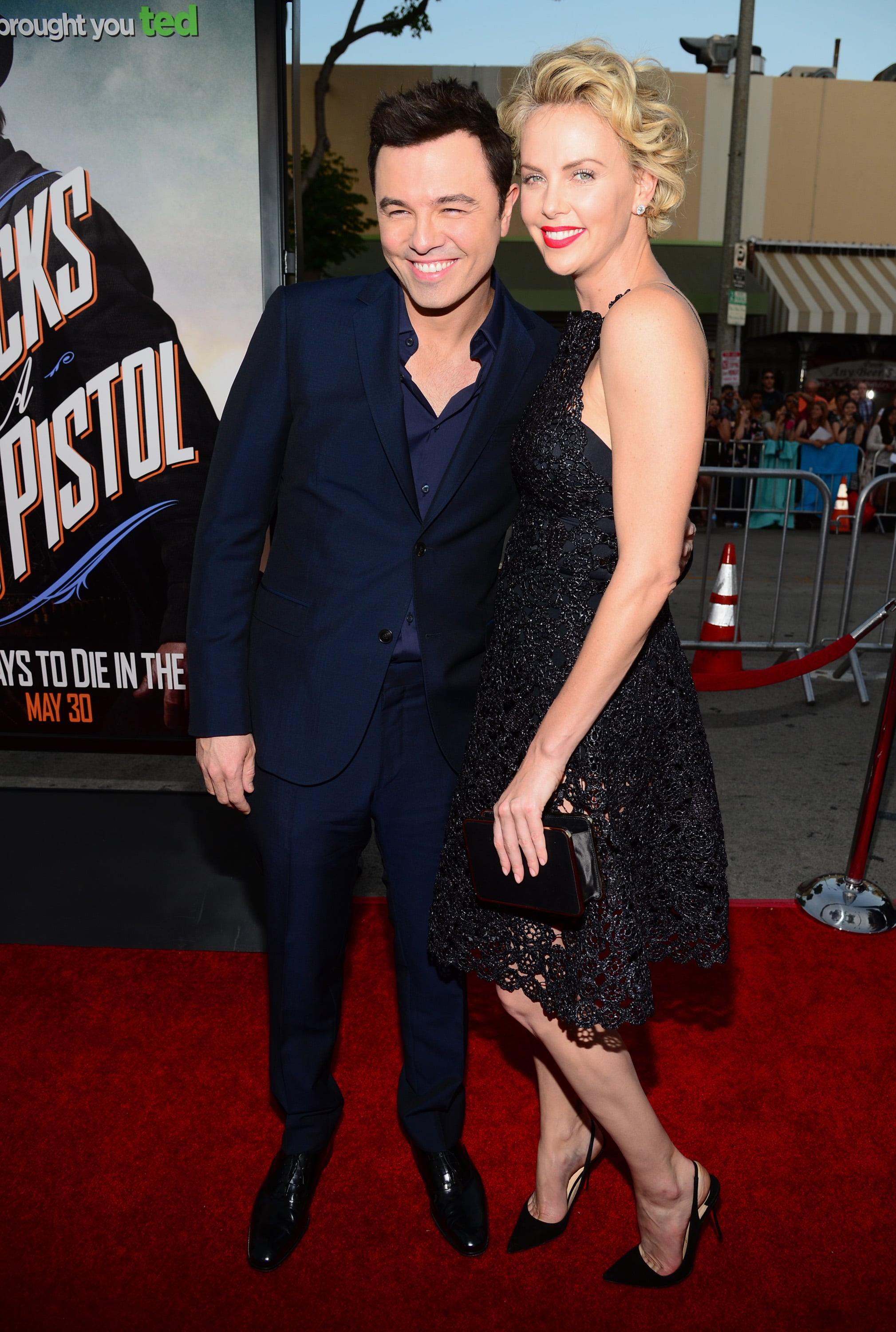 Sean Gives Charlize the Look of Love at Her Packed Premiere
