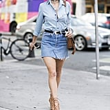 A chambray shirt creates a uniform look that can be sleek or sexy when styled like Alessandra Ambrosio.