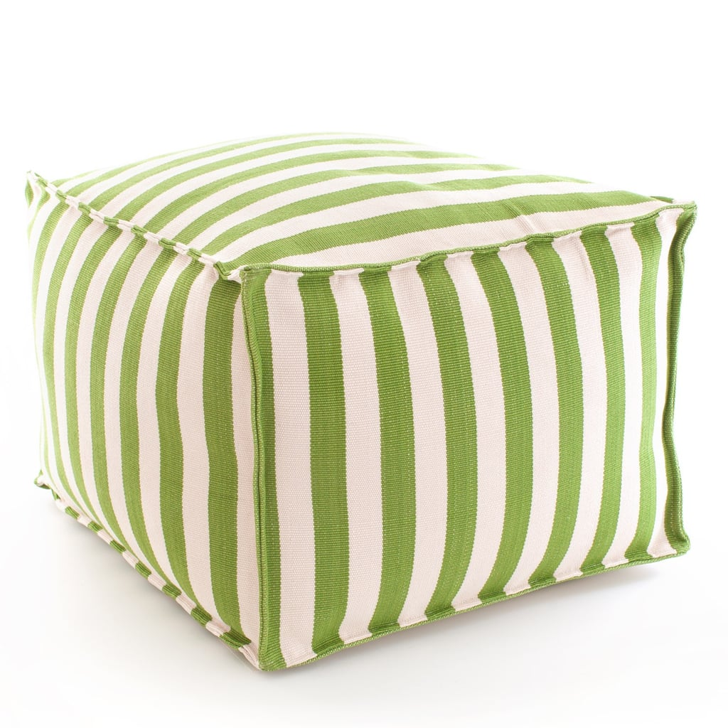Stick to soft, practical seating options like this striped green pouf ($275).