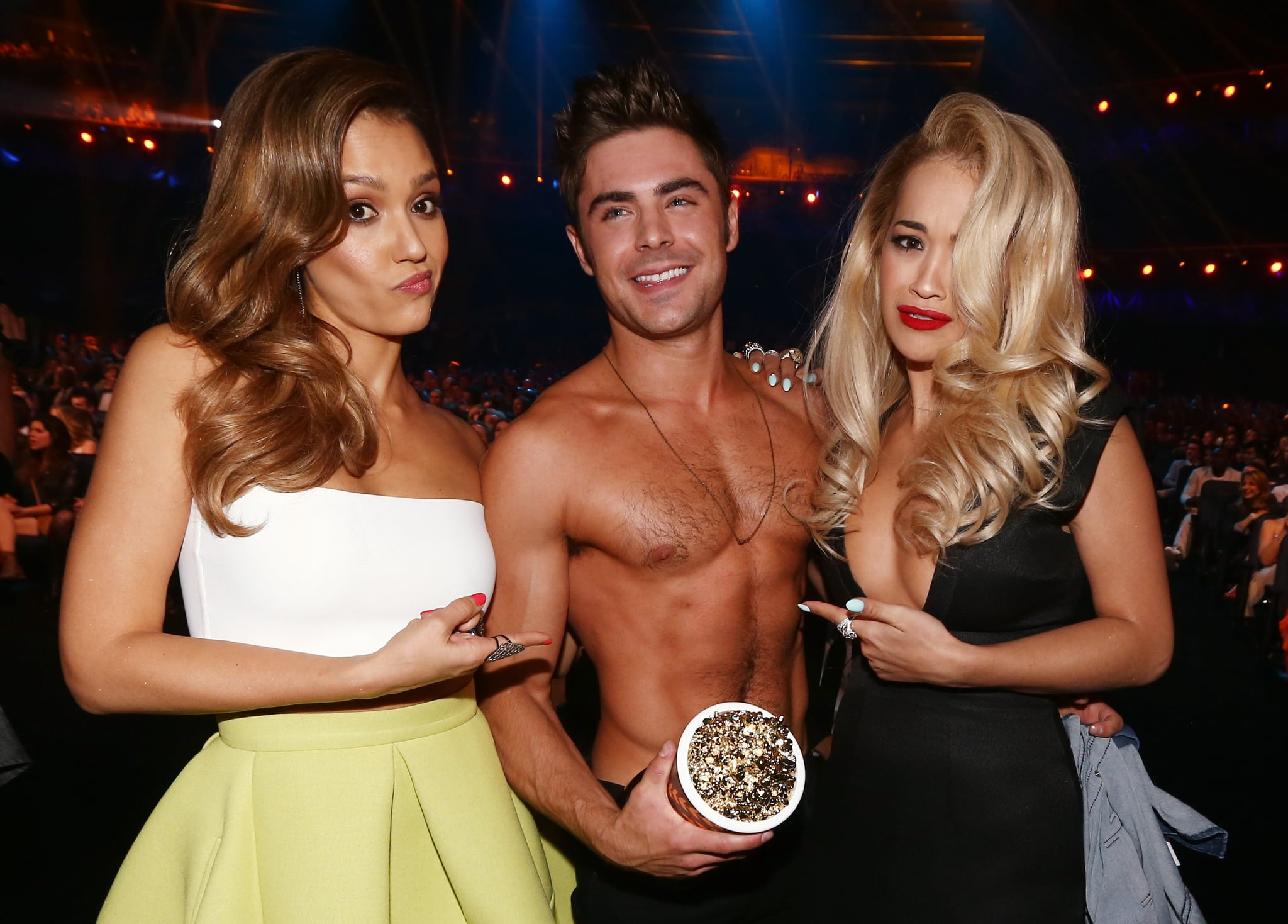 Shirtless Zac Efron found himself in the middle of a Jessica Alba and Rita Ora sandwich.