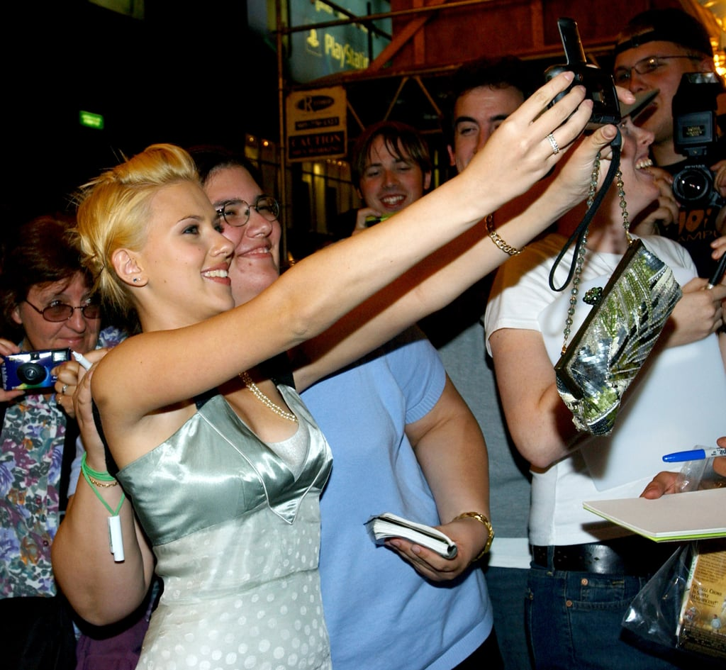 Scarlett posed for pictures with fans in 2003.
