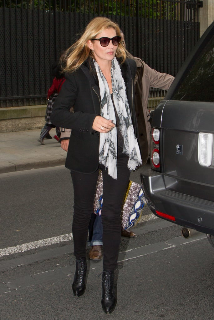 Kate Moss stepped out in London in all black, then spiced things up via a printed black and white scarf and a colourful Balenciaga bag.