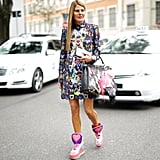Even Anna Dello Russo wore her Mary Katrantzou dress with a cool pair of sneakers — and then finished it off with a Fendi bag.