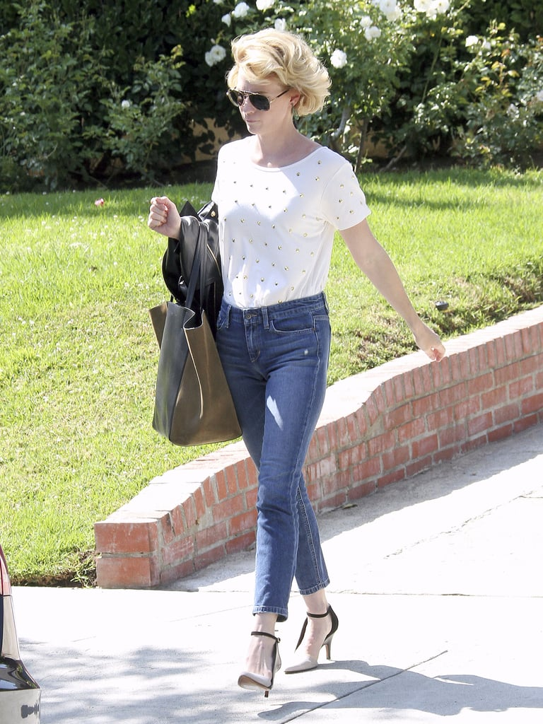 Instead of wearing a regular white tee, January Jones donned this Lovers + Friends studded white top ($97) to dress up her daytime style.