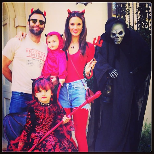 Alessandra Ambrosio and her family — fiancé Jamie Mazur and kids Anja and Noah — all dressed as devils. Source: Instagram user alessandraambrosio