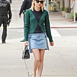 Emma Roberts Wore a Tory Burch Colorblock Sweater With Her Denim Mini Skirt