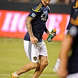 David Beckham stayed hydrated at his soccer game.