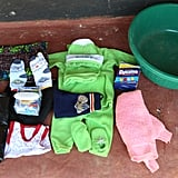 Hazel's bag included a baby blanket, cotton wool, a sarong, a baby suit, napkins, a plastic dish, Dynamo laundry detergent powder, and a polythene roll.