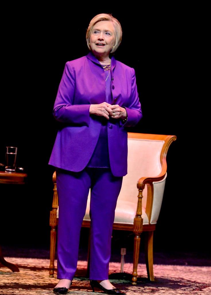 Giving a speech in a head-to-toe purple ensemble.