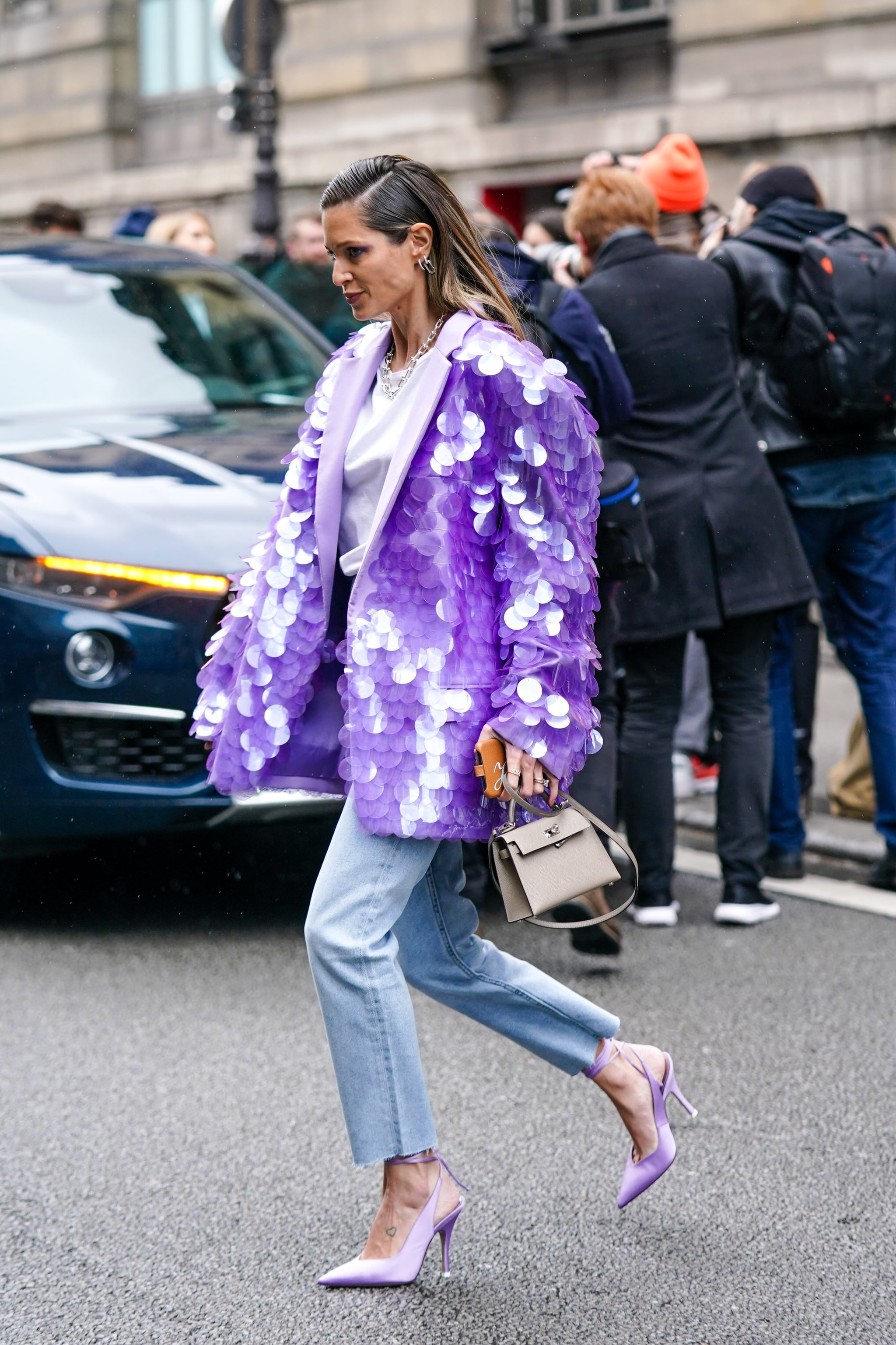 PARIS, FRANCE - MARCH 02: Helena Bordon wears earrings, a chain necklace, a white top, rings, a glittering sequin mauve jacket, a beige bag, blue ripped hem jeans, mauve pointy heeled ankle-strap pumps, outside Giambattista Valli, during Paris Fashion Week - Womenswear Fall/Winter 2020/2021, on March 02, 2020 in Paris, France. (Photo by Edward Berthelot/Getty Images)