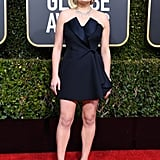 Elisabeth Moss wearing Dior Haute Couture minidress and Tamara Mellon heels.