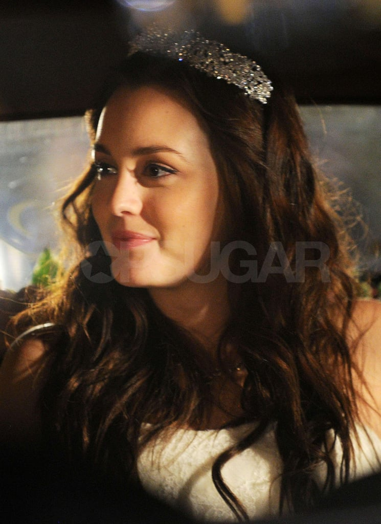 Leighton smiled in the back of her car.