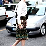 This look seriously pops, thanks to a pair of pink and orange pumps. Source: Greg Kessler