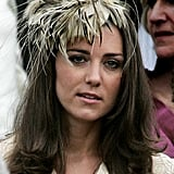 Kate favoured a similar palette for her Day Birger et Mikkelsen coat and feathery fascinator at the wedding of Laura Parker-Bowles in 2006.
