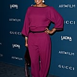 Mary J. Blige wore a raspberry pink jumpsuit with black piping from Gucci's Spring 2014 collection.