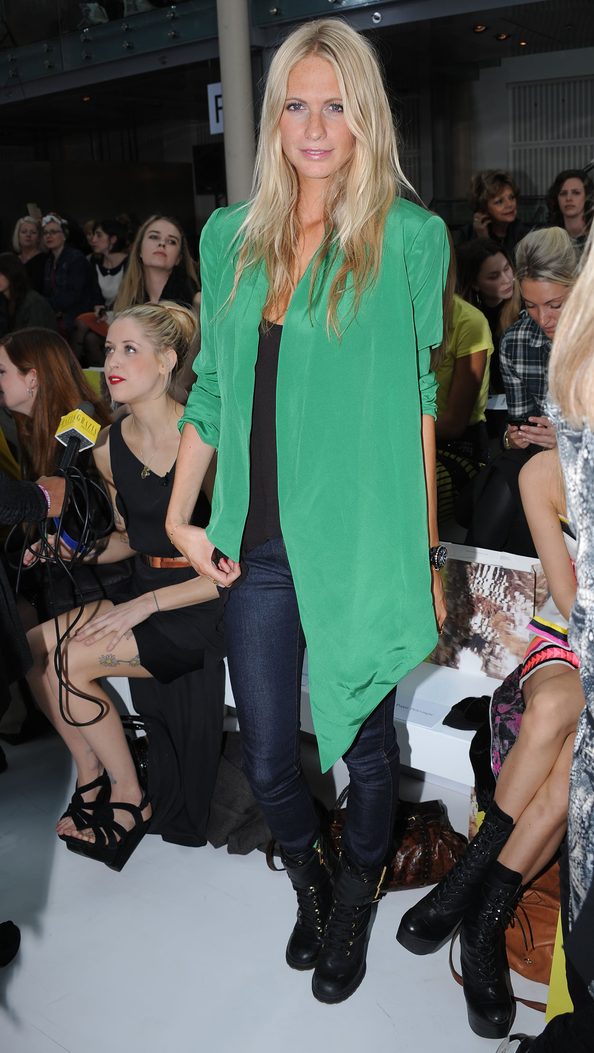 A bright, silky blazer pops against Poppy Delevigne's dark denim and black palette.