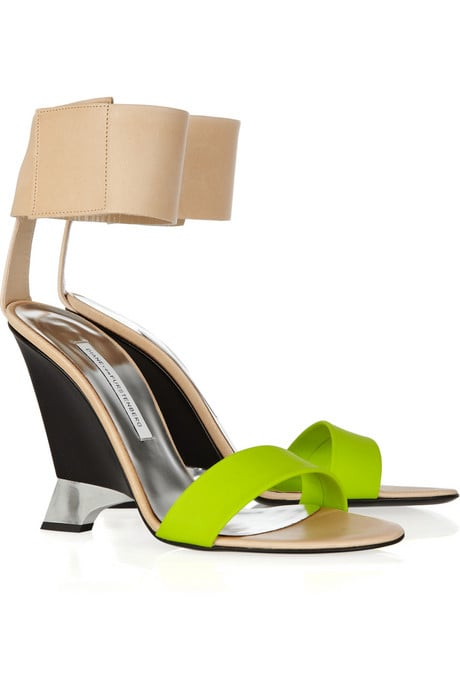 We love the sexy-cum-sporty ankle cuff detail along with the nude and neon color contrast.  Diane von Furstenberg Elan Leather and Rubber Wedges ($395)