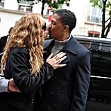 Mariah Carey stole a kiss from husband Nick Cannon during a trip to Paris in April 2012.