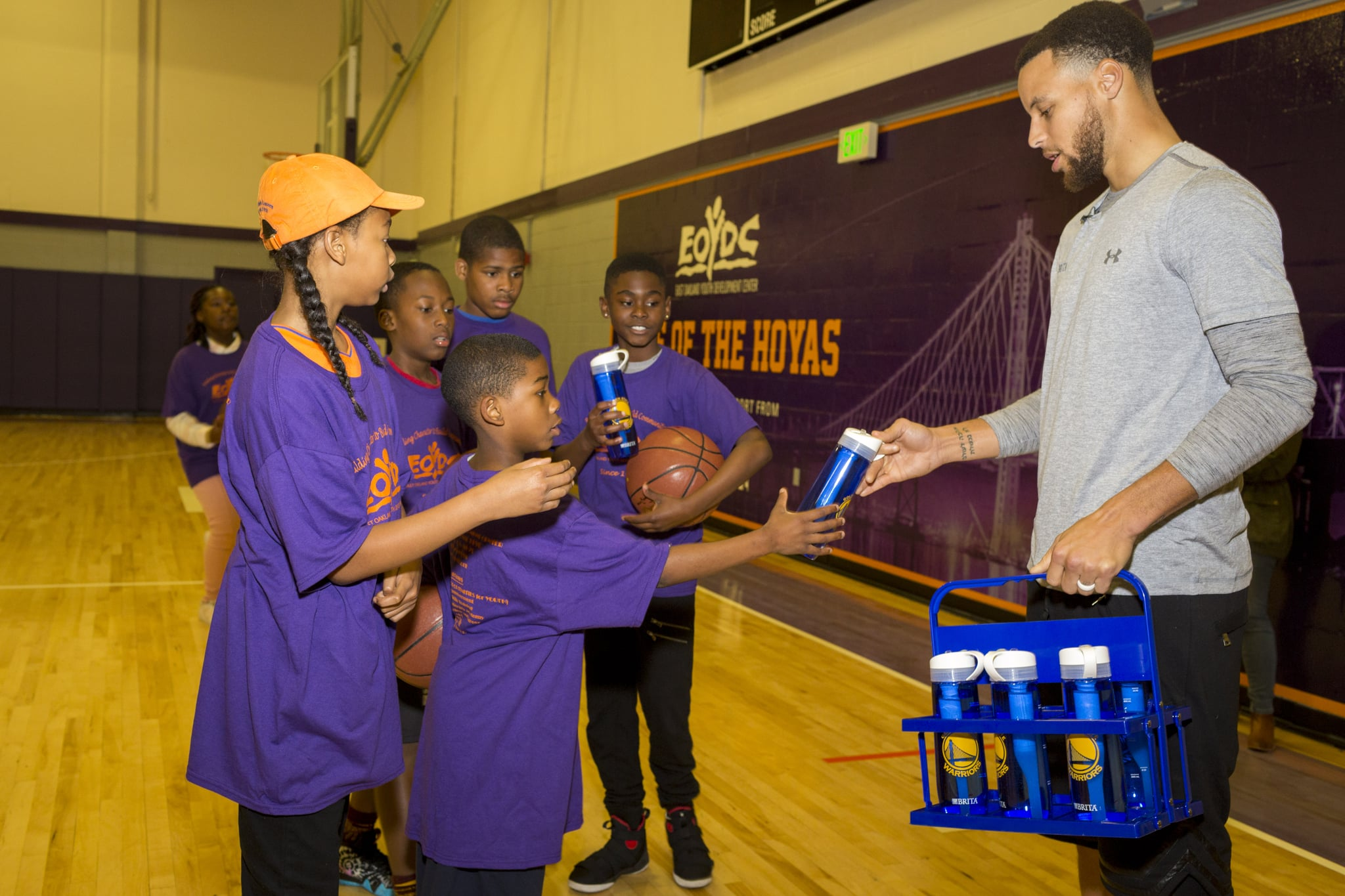 At an event announcing the Filter for the Future Grant Program, an effort to help schools limit bottled water waste,  superstar Stephen Curry handed out water to children playing a pick-up game at the East Oakland Youth Development Center Friday, March 30, 2018 in Oakland, Calif. (Eric Kayne/AP Images for Brita-Filter)