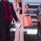 Julia wore this fabulous suit to match her flamingo pink hair when she visited Jimmy Kimmel Live in November 2018. She capped off her outfit with fun Christian Louboutin rainbow platforms.