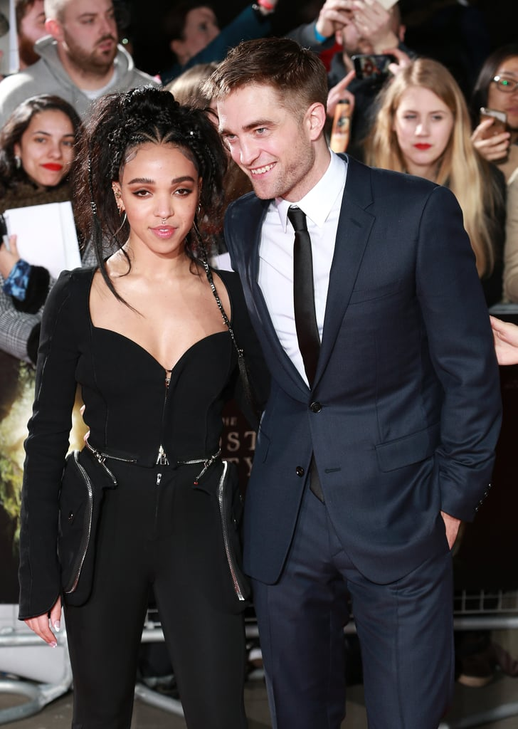 Robert Pattinson and FKA Twigs hit the red carpet together for the London premiere of his new film The Lost City of Z on Thursday. The engaged couple looked stylish as they posed for photos — Robert cut a suave figure in a blue suit while Twigs rocked a black zippered jumpsuit — before Rob linked up with his costars Sienna Miller, Tom Holland, and Charlie Hunnam, who also wore a blue suit for the occasion. It's been a while since we've seen Rob and Twigs in an official capacity — they last attended the Dance Project Gala together in December —  but we did catch them on a romantic date night in London just last week.
