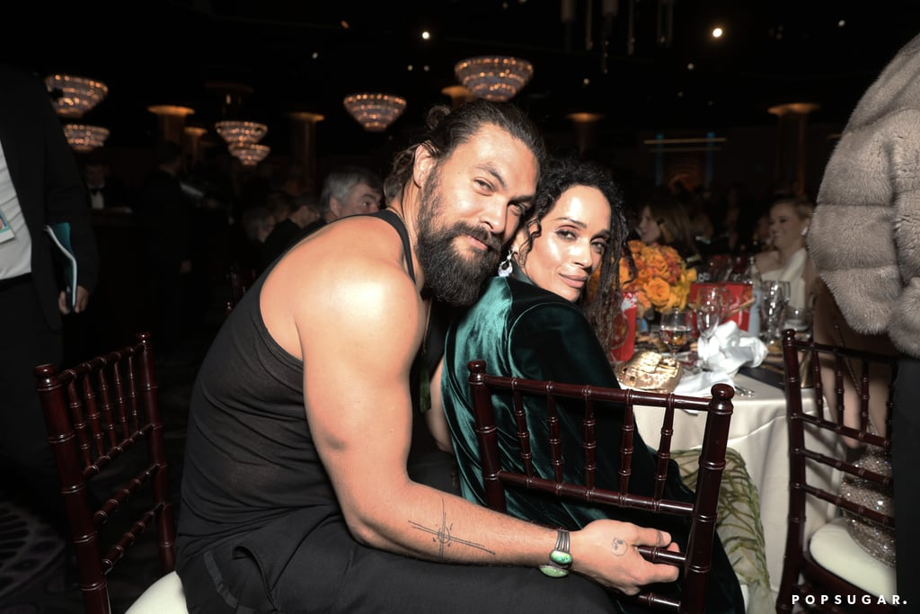 Jason Momoa put his muscles on full display as he attended the Golden Globes on Sunday night. After hitting the red carpet with wife Lisa Bonet, the actor didn't waste any time shedding his dapper green blazer inside the event. During the show, Jason and his bulging biceps were spotted in the crowd as he wore a black tank top with his hair pulled back in a ponytail. Because who says you have to wait until after the show to shed your suit and wear comfy clothes? Naturally, people completely loved the moment on Twitter. See some of the best reactions to Jason and his tank top ahead.