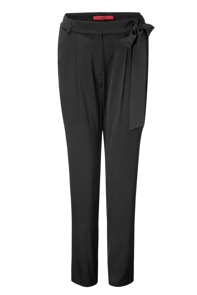 Loosely tapered with a flirty cinch, style these pants with your favorite pair of pumps, a silky blouse, and a blazer for sophisticated take on cocktail dressing. Hugo Black Hudini Pants ($375)
