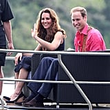 Kate Middleton waved as she sat next to Prince William on a traditional boat for their travels to Tavanipupu.