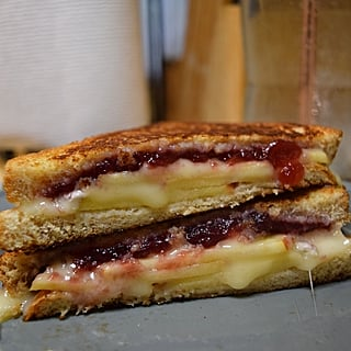 This Brie, Apple, and Cranberry Grilled Cheese Just Screams Fall — and It's Damn Delicious