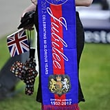 A racegoer held memorabilia at the derby.