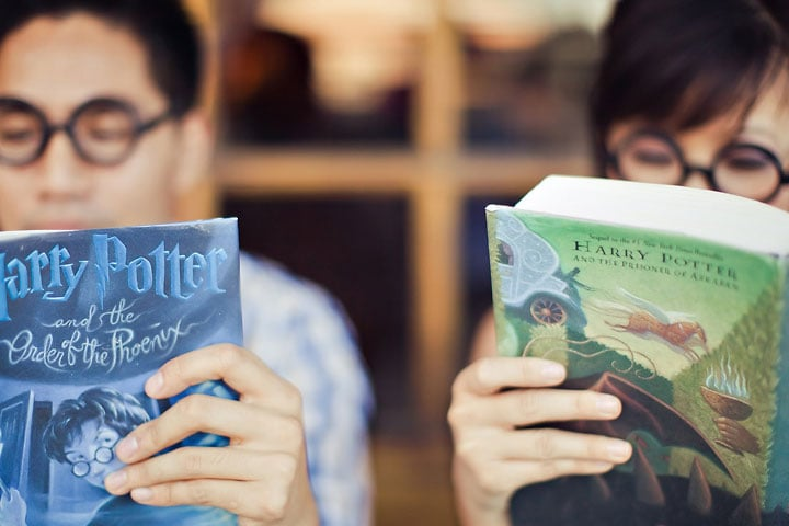 The couple that reads Harry Potter together, stays the coolest together. Photo: Orange Turtle Photography