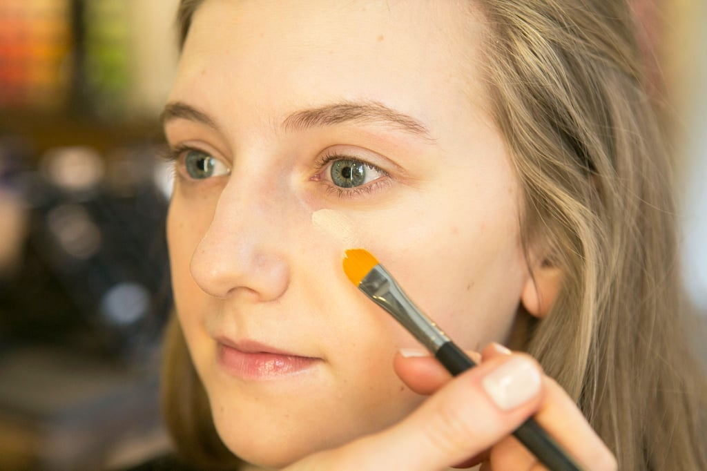 "Follow up with a longwear concealer, but Bettelli advises to keep the application light. ""You don't want to overuse it,"" she says,""because it gets cakey. A brush is a good option — pat for more coverage and then sweep to sheer."""