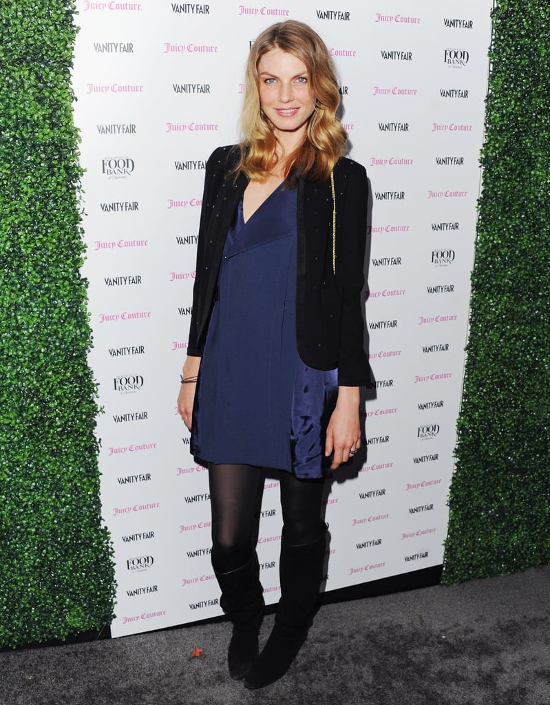 Model Angela Lindvall kept it cool in a navy blue asymmetrical-neckline dress and black blazer. She finished off the darker ensemble with a pair of slouchy black knee-high boots.